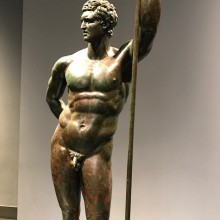 Roman Bronze: a man portrayed in heroic nudity. Rome National Museum